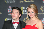 Sloane Morgan Siegel and Savannah Kennick are seen attending the 18th Annual International Beverly Hills Film Festival Opening Night Gala Premiere of 'Benjamin' at TCL Chinese 6 Theatres in Los Angeles, California.