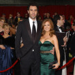 Sacha Baron Cohen and Isla Fisher put their height difference on full display.