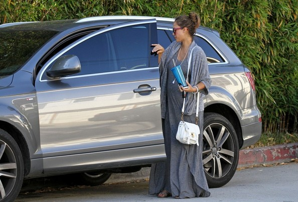 Pregnant Jessica Alba dresses in gray while out visiting a friend's home.