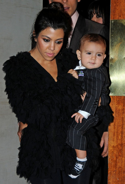Kim Kardashian leaves Via dei Mille restaurant in Soho after yet another 30th birthday party.  Joining her were her sister Kourtney, Scott Disick and their baby Mason Dash Disick (b. Dec 14 2009).