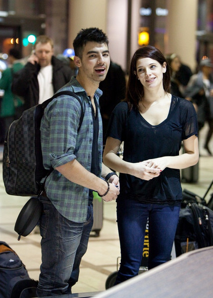 Ashley Greene Ashley Greene and Joe Jonas are cute and happy as they arrive at LAX (Los Angeles International Airport). Upon arriving they are swarmed by tons of fans.