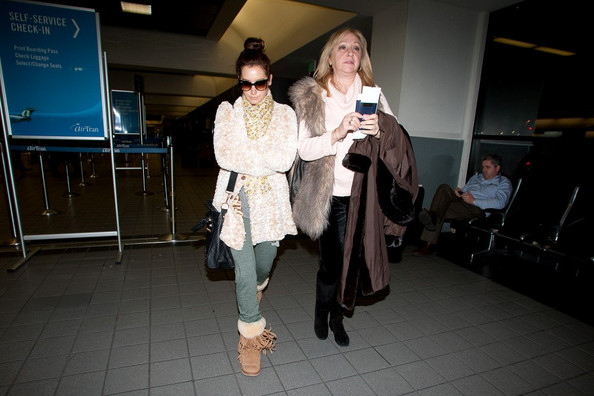 Ashley Tisdale Ashley Tisdale and her mother Lisa Tisdale prepare to depart LAX (Los Angeles International Airport).