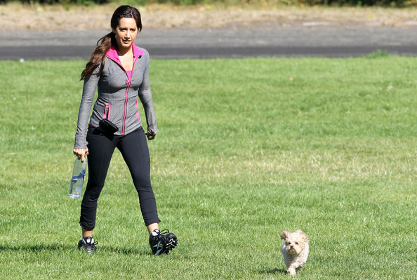 Ashley Tisdale Ashley Tisdale brings her pup Maui to the set of her new show