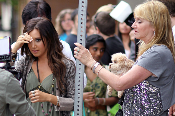 Ashley Tisdale Ashley Tisdale surprises the winner of the JCPenney Back To School Shopping Spree and accompanies her around the store. Ashley's mom Lisa and pup were also present.