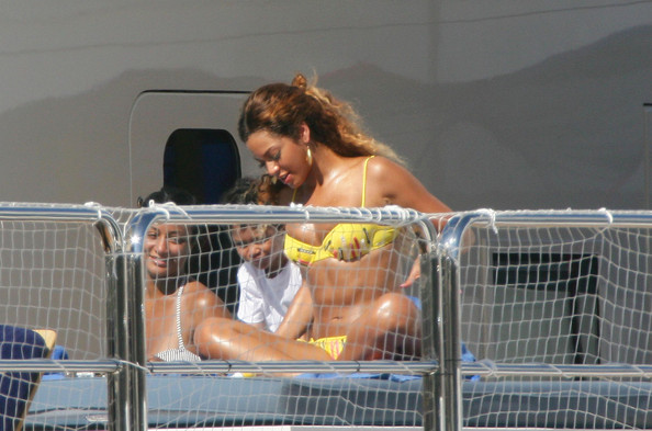 Beyonce Knowles shows off her toned body in a bright yellow bikini.