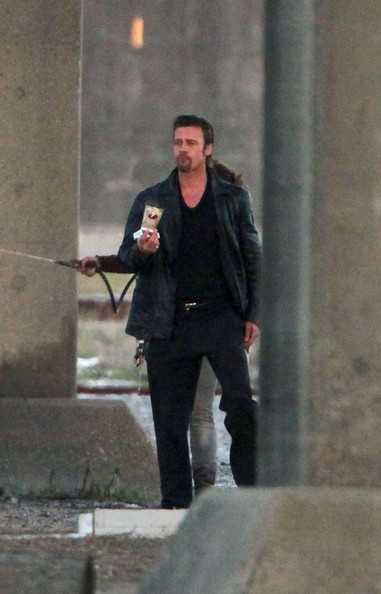 Brad Pitt continues to film scenes under a road bridge from his new movie Cogan's Trade.
