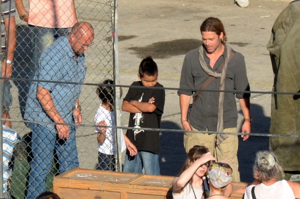 Brad Pitt's adopted sons Maddox (b. August 5, 2001) and Pax (b. November 29, 2003) visit on the set of Pitt's latest film 'World War Z.'.