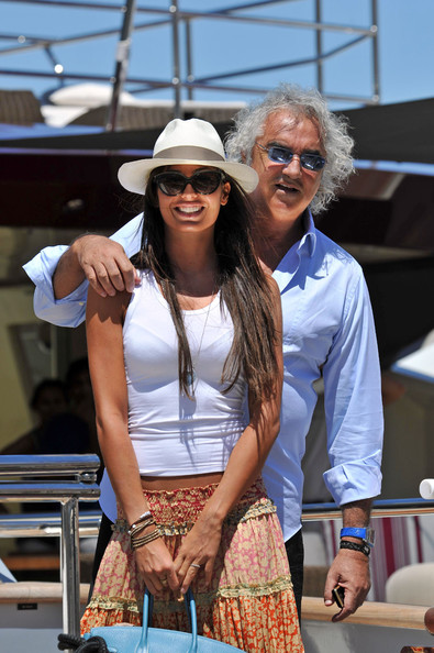 Flavio Briatore and wife Elisabetta Gregoraci stroll through the markets in Saint-Tropez before heading off in their private helicopter.