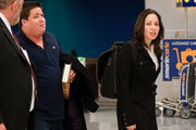 Chaz (formerly Chastity) Bono, who is currently undergoing a sexual reassignment, lands at JFK International Airport with his girlfriend Jennifer Elia and a novel by Dan Brown.
