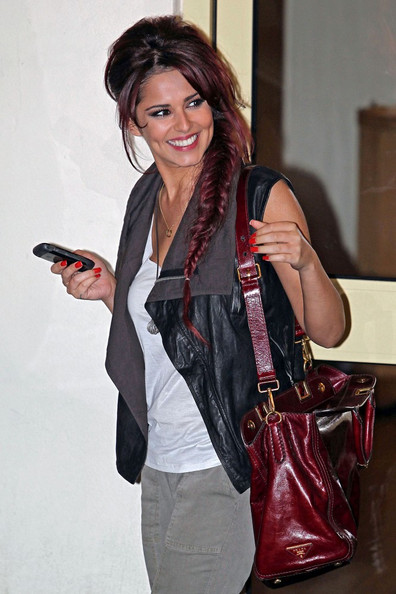 Cheryl Cole Cheryl Cole checks her messages on her Blackberry as she leaves the Fountain Studios after judging the second live show of the X Factor.