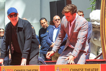 Chris Hemsworth Kevin Feige Marvel Studios' 'Avengers: Endgame' Cast Place Their Hand Prints In Cement At TCL Chinese Theatre IMAX Forecourt