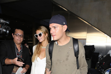 Chris Zylka Paris Hilton and Chris Zylka at LAX