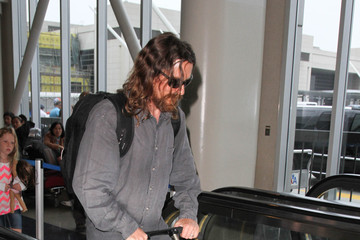 Christian Bale Christian Bale and Son Are Seen at LAX