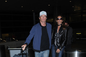 Cindy Crawford Rande Gerber and Cindy Crawford Walk Hand in Hand at LAX