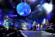 Chris Martin performs with Coldplay in concert at the O2 Arena.
