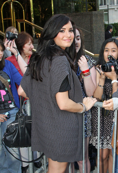 Demi Lovato leaves the Trump International Hotel and greets her fans before heading out.