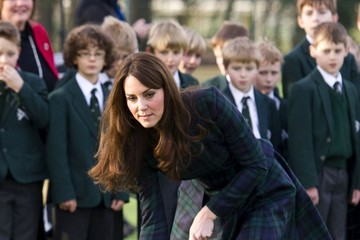 Kate Middleton Plays Field Hockey in Alexander McQueen