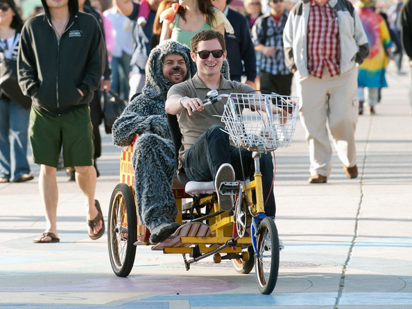 "***NO GERMANY/SWITZERLAND RIGHTS***.Elijah Wood and actor Jason Gann (in dog costume) film their new TV show ""Wilfred"".  They spend the day on the popular Venice Beach Boardwalk: riding a tandem bicycle, sharing cotton candy on a park bench, and even visiting a medical marijuana doctor and dispensary."