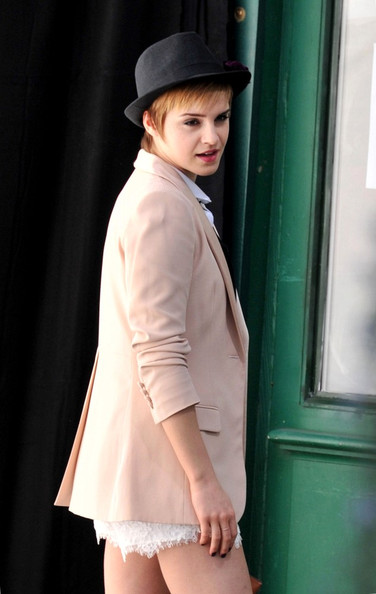 Emma Watson Emma Watson poses outside a bookstore for a new advertisement for Lancome, directed by famed photographer Mario Testino.