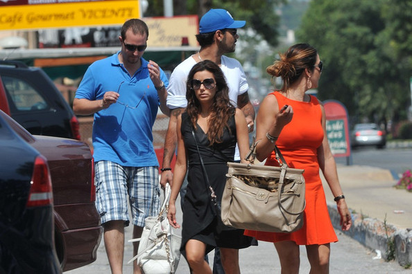 """Eva Longoria carries """"The Hunger Games"""" as her vacation reading material while out strolling about the town with boyfriend Eduardo Cruz and a couple friends. .NON0EXCLUSIVE     July 2, 2011."""
