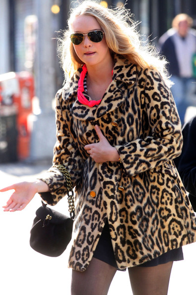 Gemma Ward Model Gemma Ward hails a taxi cab on her 22nd birthday with some friends in the East Village wearing a cheetah- patterned animal-print coat.