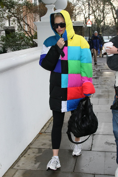 Gwen Stefani looks warm in a rainbow colored winter coat as she returns home from the gym.