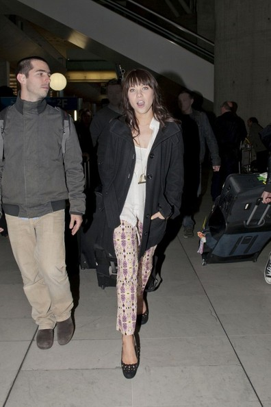 Carly Rae Jepsen arrives at Roissy Airport wearing a pair of printed pants.