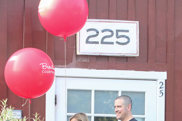Jim Toth Reese Witherspoon and Husband Jim Toth Play With Red Balloons