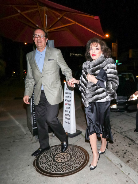 Joan Collins And Percy Gibson Outside Craig's Restaurant In West Hollywood