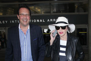 Joan Collins And Husband Percy Gibson Hit LAX