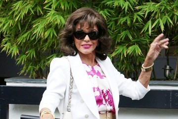 Joan Collins Joan Collins Waves to Fans