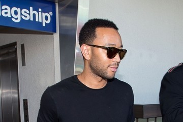 John Legend Chrissy Teigen and John Legend at LAX