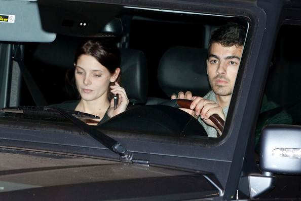 No sign of Joe Jonas's purity ring, as he spends the day with Ashley Green shopping for doggy toys.