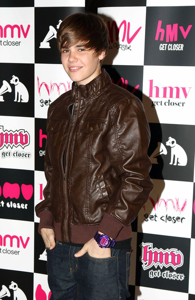 "16 year-old pop sensation Justin Bieber draws a large crowd of screaming fans at an HMV in the Westfield Shopping Center where he signed copies of his debut album ""My World.""."