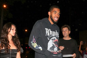 Karl-Anthony Towns and Kawahine Andrade are seen in Los Angeles, California.