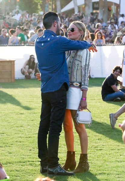 Bosworth rocks the Charlotte boot at Coachella. Papjuice/Bauergriffin.Com