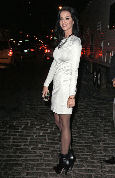 On Fashion's Night Out, Katy Perry heads from the meat packing district to the Dior store on 57th street, buys a bag at Chanel (next door) and then makes her scheduled appearance at Giuseppe Zanotti.