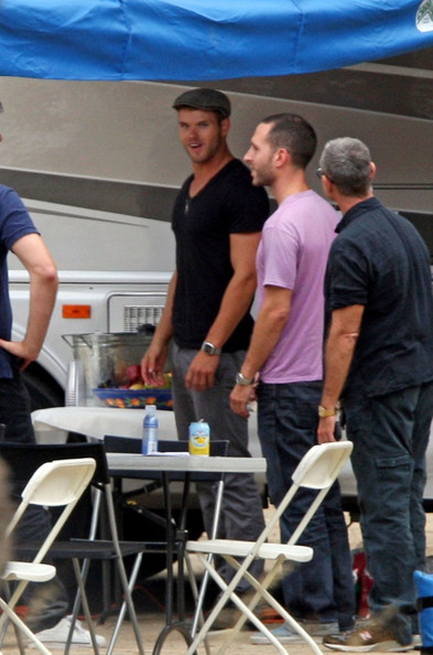 Kellan Lutz takes a break by his trailer on the set of a photo shoot outside Los Angeles.