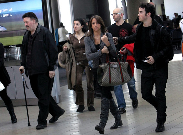 Kevin Jonas Kevin Jonas and wife Danielle Deleasa walk through LAX, Los Angeles International Airport, before boarding a departing flight.