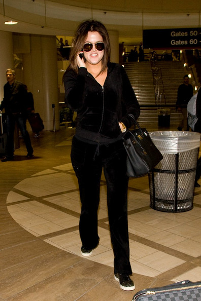 Khloe Kardashian Khloe Kardashian takes a call as she arrives at LAX (Los Angeles International Airport).