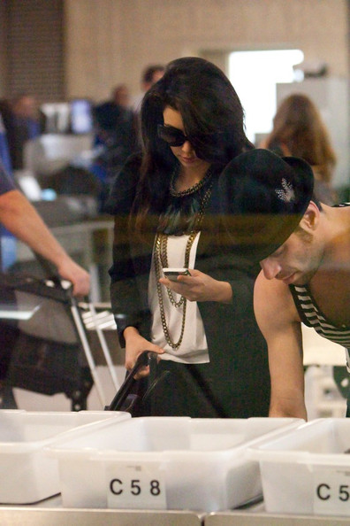 Kim Kardashian Kim Kardashian catches an early morning flight and prepares to depart LAX (Los Angeles International Airport).