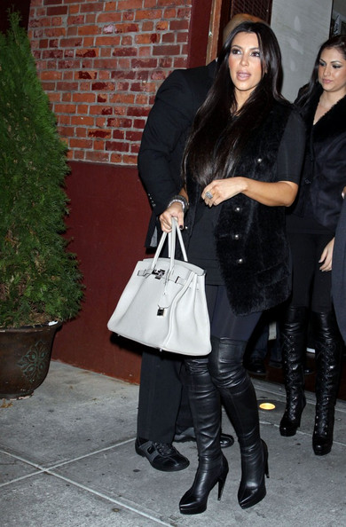 Kim Kardashian Kourtney Kardashian, Scott Disick and their son Mason (b. December 14, 2009)host a small birthday dinner for Kim Kardashian at Via dei Mille .