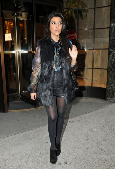 Kourtney Kardashian Kim Kardashian has lunch at Serafina with her sister Kourtney before doing some shopping at Bergdorf's on Fifth Avenue.