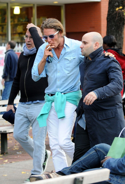 Lapo Elkann looked smart in a pastel blue linen button-down and white pants while taking a stroll with friends.