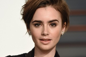 Lily Collins Stars at the Vanity Fair Oscar Party