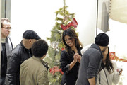 Eva Longoria can hardly let go of her boyfriend Eduardo Cruz as she shops in a mall along with Eduardo's sister, Monica Cruz.  The loved-up couple take several pauses during the trip to passionately kiss in the stores.