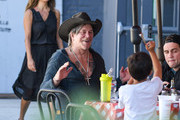 Mickey Rourke pizza with friends