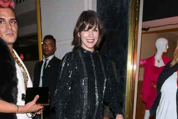 Milla Jovovich Celebrities Attend the Opening of What Goes Around Comes Around
