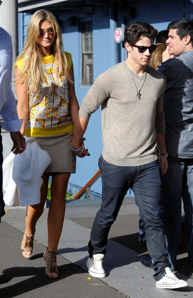 Nick Jonas and Delta Goodrem on a Boat