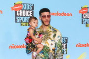 Lonzo Ball and Zoey Ball are seen attending the Nickelodeon Kids' Choice Sports at Barker Hangar in Los Angeles, California.